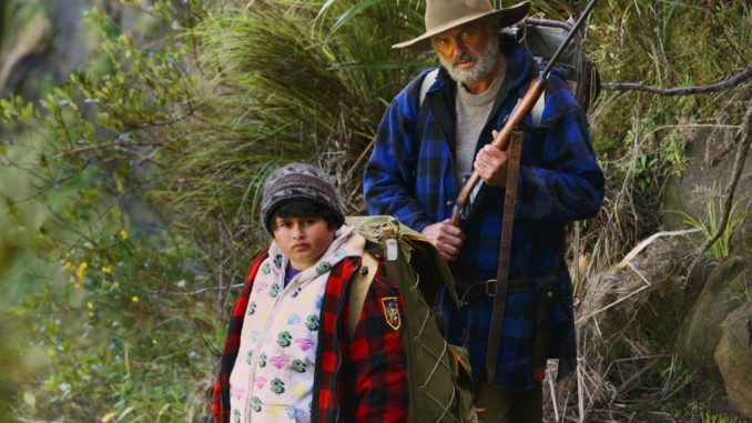 """This image released by The Orchard shows Julian Dennison, left, and Sam Neill in a scene from """"Hunt For The Wilderpeople."""" (The Orchard via AP)"""